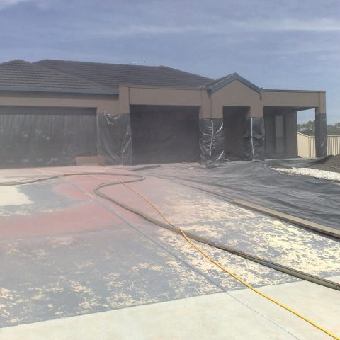 Sandblast Driveway to remove paint